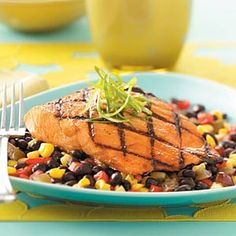 Grilled Salmon with Black Bean Salsa:  1 salmon fillet with 2/3 cup salsa equals 324 calories, 13 g fat. 67 mg cholesterol, 23 g carbohydrate, 4 g fiber, 28 g protein