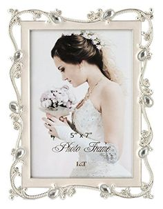 L&T Metal Picture Frame Silver Plated with Cream White En... https://www.amazon.com/dp/B01GBB8TNG/ref=cm_sw_r_pi_dp_x_lwI7ybG45DWAY