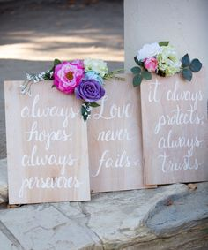 DIY 1 Corinthians 13 Wedding Aisle Signs. I made these signs on 18x14 plywood. The writing is free-hand (although I wish I'd used a stencil) and I hot-glued silk flowers on the corners. I made a total of 5 signs (starting with Love Is Patient, Love Is Kind) and used them as our wedding aisle decor. ❤️