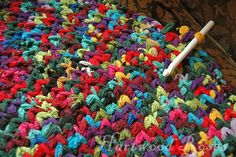 Using sock loopers from Crazy as a Loom to crochet an oval rug. I love the random mix of bright, happy colors!