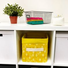 Organize your sewing or craft space with a set of these Quilty Storage Bins. Learn how to make a fabric storage bin with this tutorial. Fabric Storage Baskets, Fabric Boxes, Storage Bins, Small Storage, Craft Storage, Storage Solutions, Sewing Spaces, Sewing Rooms, Small Quilt Projects