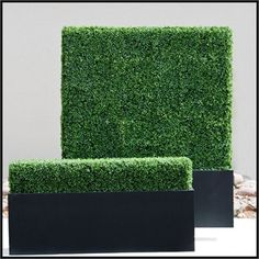 Artificial Hedges - Outdoor Faux Boxwood Hedges in black planters - http://www.hooksandlattice.com/outdoor-artificial-hedges.html