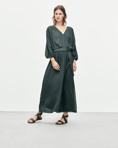 "New! Did you know you can now find out how every garment was made? Click the ""Who Made It"" Tab. <br /><br /> A luxurious belted silk chiffon dress with a generous batwing sleeve and dramatic skirt. Wide and ancle long skirt part. Dress up with high heel"