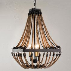 Nautical Rope and Bronze Square Chandelier Nautical rope adds rugged textural appeal to this square 3 light bronze chandelier. A favorite for coastal and rustic interiors