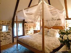 Bedroom with stone walls - La Maisonnette: French holiday cottage in South West France Stacked Stone Walls, Bedroom Lighting, Light Bedroom, Natural Bedroom, French Cottage, Bedrooms, Interior Design, House, Furniture