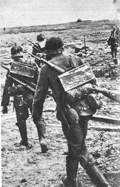 Germans at Stalingrad... most costly battle in history. *note the extra MG ammo cans carried on their backs.