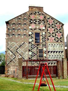 Glasgow, Scotland barn quilt ~ Various blocks {photo by Play Park | Flickr.  Comments mention this was painted in 1978; it seems barn quilts go back aways!}