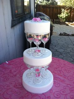 separated wedding cakes   10, and 12 inch round tiers separated with wine glasses (brides ...