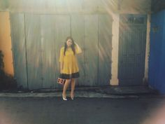 Yellow blouse mix with black skirt and silver shoes. Fashion street.