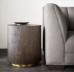 RH Modern's Machinto Round Side Table:Designed by the Van Thiels, our collection mixes bold proportions and clean, mitered lines in a style that's both rustic and refined. Inspired by 1970s postmodern design, it features American white oak hand finished to highlight its warmth and naturally rich grain.