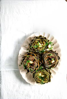 Once they're done, sprinkle with parsley and more lemon juice — and enjoy! | Easy Foil-Packet Roasted Artichokes