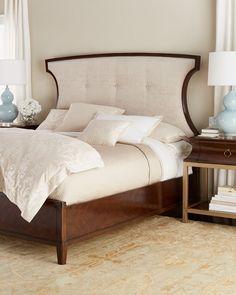 """Handcrafted bed. Graceful cutouts on the sides and subtle concave shaping and button tufting on the headboard. Hardwood frame; polyester upholstery. Assembly required. 80.75""""W x 89.75""""L x 66""""T. Import"""