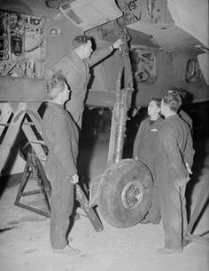 A huge wind shield shelters trainees during instructional engine running. This Fitters (E) class on engine servicing are on a Hawker Sea Hurricane. Royal Marines, Ww2 Aircraft, Royal Navy, Military History, Troops, Wwii, Wealth, Planes, Europe