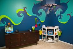 I always envisioned having a colorful nursery...and since we didn't know the sex of our baby, it was even more fun playing with gender neutral colors! (And, any 'under the sea' nursery wouldn't be complete without a fish tank!)