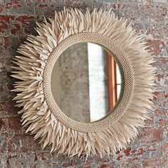 this is just a fun and interesting mirror....hmmm maybe even one that could lay flat on a table as a centerpiece or something