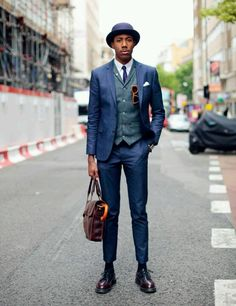 Snapped by Elle magazine at London Collections:Men  Wearing- Suit: River Island, white oxford shirt: Lacoste, Brogue: Dr Martens, leather satchel: Dr Martens, sunglasses: Finlay & Co and purple bowler hat: Atelier millinery, umbrella: vintage #MANABOUTTOWN #LCM