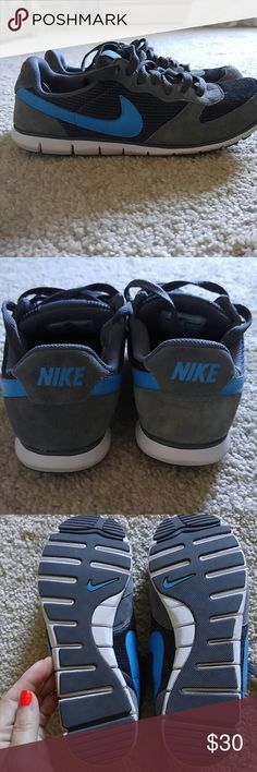 Nike women's sneaker Grey with blue swish suede accents barely worn only inside comes with white laces also Nike Shoes Athletic Shoes