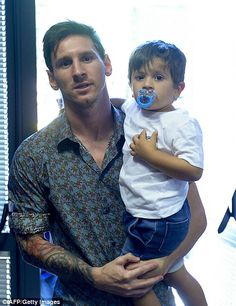 Messi with his son Thiago at farewell to Pedro leaving barca