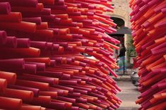 Using only swimming pool noodles, design studio Les Astronautes has turned a dark, narrow alley in Quebec City into a dreamy playground.