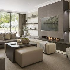 Very contemporary and neutral family room off the kitchen at the Wentworth…