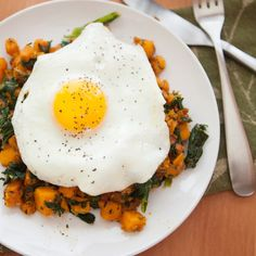 Sweet Potato and Kale Hash with a Fried Egg.  A healthy and hearty way to start your morning off right!