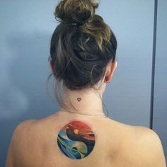 Tattoo Ideen Frauen - Colorful Yin Yang tattoo on the back. This Yin Yang symbol plays with .