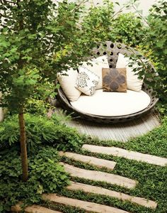 Round daybed, tucked away with some vegetation for privacy. I would nap here. I also like the long pavers for the path.
