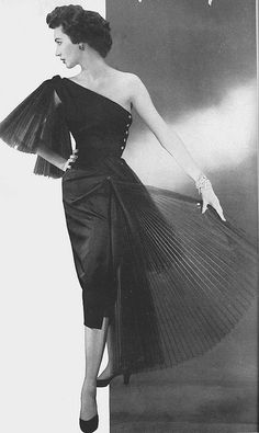 """Do Modelling a silk taffeta cocktail dress.   Along with Lisa Fonssagrives, Sunny Harnett, Dorian Leigh, her sister Suzy Parker and Jean Patchett, Dovima personified the distinguished and regal look of the 1950s. """"I never thought of myself as a beautiful woman,'' she once said while being interviewed, ''As a child, I was a gangly, skinny thing and I had this ugly front tooth that I broke when I was playing dress-up in my mother's clothes.''"""