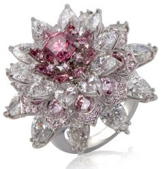Argyle Pink Diamond Jewelry Outlet Opens in India - The Shalimar ring set with the 1.25 carat fancy vivid purplish pink round Shalimar diamond
