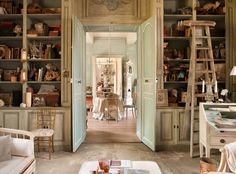 Fabulous antique white floor to ceiling cabinets / built ins. Le Grillon Voyageur
