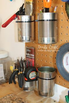 Zip-ties right into the peg board and soup cans! Fabulous tool storage!