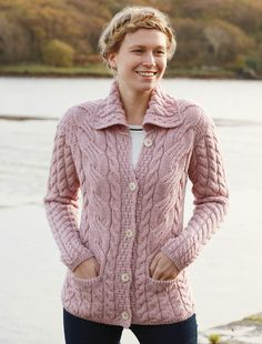 One of our most popular ladies Aran cardigan is our Honeycomb Button-Up Cardigan. A practical and versatile button-up cardigan, and it's wide range of colors makes it suitable for all seas.Cable Knit Button-Up Cardigan - Winter RoseThis Pin was disco Knit Cardigan Pattern, Hoodie Pattern, Cable Knit Cardigan, Cable Knit Sweaters, Ladies Cardigan Knitting Patterns, Handgestrickte Pullover, Cardigan En Maille, Matching Sweaters, Sweater Shop