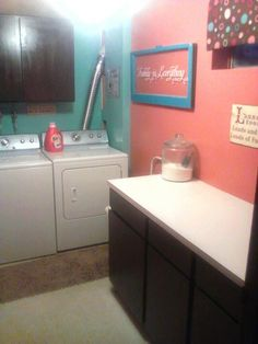 Our rental laundry room after. Orange & teal.