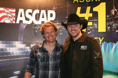 """Cory Batten (left) and Chris Young pose for photos at the No. 1 party for """"Gettin' You Home (Little Black Dress)"""" on Nov. 24, 2009. Photo By: Marilu White"""