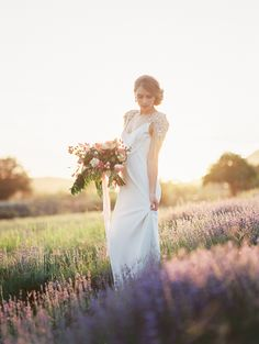 Bride in an embellished Anna Campbell wedding gown // Romantic engagement shoot in a lavender field