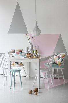 Okay it's a bit overstyled ( I'm not a big fan of the un-neccessary cushion) but the colours and shapes are very cool. The chairs look like Hay. And the colours are very Hay too. Pinned from Trendenser