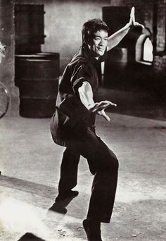 """Bruce Lee posing (""""the dragon whips its tail!"""") during the back alley scuffle in """"Way of the Dragon""""."""