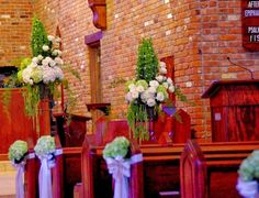 Bells of Ireland topiaries with   Hydrangea, roses, and green amaranths