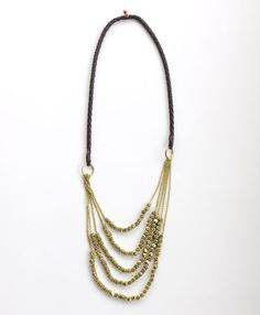 Chunky geometric beads  strung from braided vegan leather instantly elevate you to rockstar status.