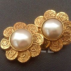 A personal favorite from my Etsy shop https://www.etsy.com/listing/224466784/auth-chanel-vintage-huge-flower-cc-gold