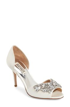 f4b8b4888c8265 A dazzling crystal flower accents the open toe of this lustrous satin  d Orsay pump