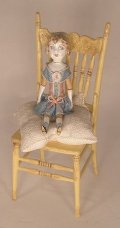 Doll Sitting on Yellow Chair by Gale Elena Bantock