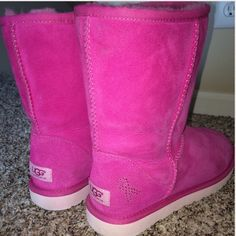 HOST PICK  BREAST CANCER UGG BOOTS UGG Classic Short Raspberry Pink Breast Cancer Awareness Boots  These boots are limited edition and are very rare!  These gorgeous boots are super cute and comfortable  They are perfect for the winter and are in great condition!! Make me an offer  UGG Shoes