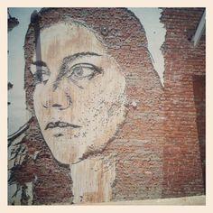 laster on brick mural, Abbot Kinney Blvd. Venice Los Angeles.