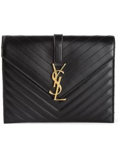 Majorly crushing is an understatement for how much I ADORE this YSL clutch! | black Yves Saint Laurent leather clutch