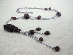amethyst colored glass beads. Pendant style necklace