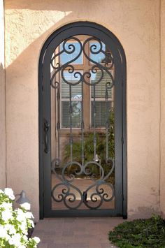 Wooden Fence Lighting Ideas and Wooden Fence Gate Hardware. Arch Gate, Entrance Gates, Entrance Doors, Door Gate, Gates For Sale, Iron Garden Gates, Iron Front Door, Wrought Iron Doors, Metal Gates