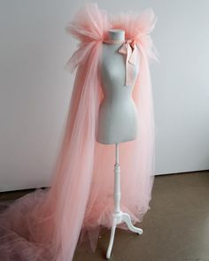 """""""Every year we try to create a costume 'story,' and Martha generally opens the story. We like to have a universal theme that appeals to both kids and adults. She knew she wanted to dress up as something 'good,' so her Fairy GrandMartha costume against the dark forest really worked,"""" says Marcie.Here, the completed fairy costume in all of its pink tulle glory."""