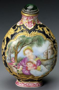 imperial 18th-19th century enameled ovoid form snuff bottle with a vignette of mother and child on each side, surrounded by a gold floral design, brought $74,880.