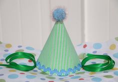 Fabric birthday party hat with green stripes. This was designed for a train theme party.  https://www.etsy.com/listing/191061672/green-striped-fabric-birthday-hat-first